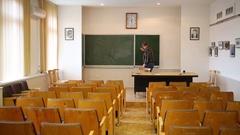 Teacher cleaning blackboard in classroom in branch Stock Footage