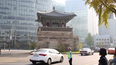 Small pagoda in middle of street and working traffic policeman Stock Footage