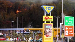 Firefighters and volunteers fight fire near gas station in Haifa, Israel. Stock Footage