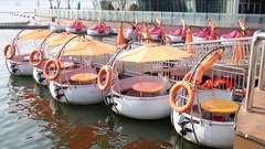 Quay with rows of circle motor boat at rest and man sitting in one in Seoul. Stock Footage