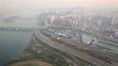Highway with cars near highrise building, Han river and bridges Stock Footage