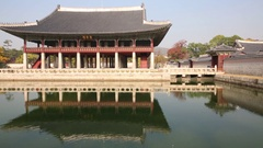Building of palace on pond and bridge in Gyeongbokgung. Stock Footage