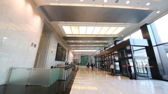 Spacious hall with doors, wickets and people of Yuksam building Stock Footage