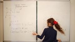 Girl explaining problem solution writing on white blackboard. Stock Footage