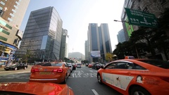 Taxi and other cars driving on street near buildings Stock Footage