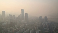 Rows of highrise business and apartment buildings in smoke in Seoul. Stock Footage