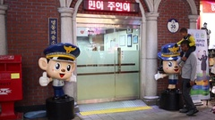 Entrance to kids police station in store and negro man with child Stock Footage