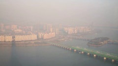 Panorama of Han river, bridges and highrise buildings in smoke in Seoul. Stock Footage