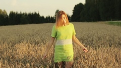 Beautiful and happy woman walking in wheat field. Stock Footage