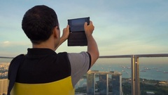Male tourist taking picture of downtown in Singapore Stock Footage