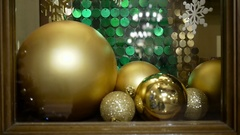 Close-up New Year's and Christmas decorations in window. Gold balls Stock Footage