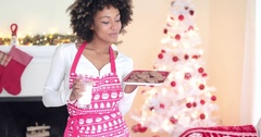 Cute young woman holding milk and cookies Stock Footage