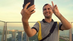 Male tourist taking selfie in Singapore Stock Footage