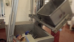 Machine processing of raw meat for production. water is poured into the tank Stock Footage