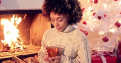 Young woman drinking spicy lemon tea Stock Footage