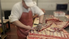 The butcher cut up the carcass of beef and pork in the sausage production Stock Footage