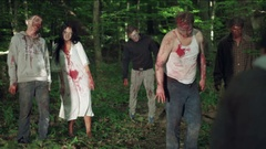 Zombie eat a man in the forest. Stock Footage