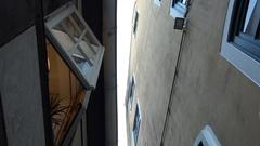 4k Very small alley with sculptures tilt down in city Bremen famous area Schnoor Stock Footage