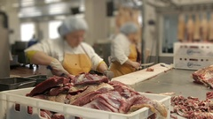 Fresh raw meat cut by the butcher for cooking Stock Footage