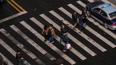 Aerial view of people on busy pedestrian crossing, Shanghai, China. Time lapse Arkistovideo