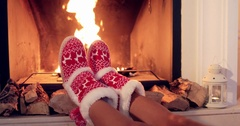 Young woman relaxing in Christmas booties Stock Footage