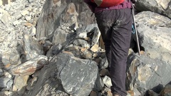 Overcoming a rocky slope climbers Stock Footage