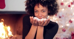 Adorable sexy woman blowing out confetti Stock Footage