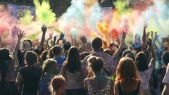 Many young people at the festival of colors Stock Footage