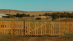 A fence on a farm in the countryside Stock Footage