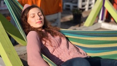 Girl relaxing while having a nap on hammock and catching sun Stock Footage