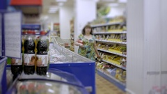 Woman in the grocery store makes shopping Stock Footage