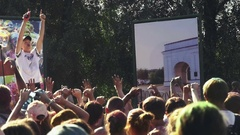 Lead gets the crowd on the festival of colors Stock Footage