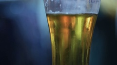 Beer Glass in a Pub. Glass of beer with an out of focus people on background. Stock Footage