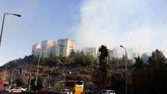 Firefighters and volunteers fight fire in a street in Haifa, Israel. Stock Footage