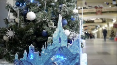 New Year's and Christmas tree decoration in shopping mall whith ice castle Stock Footage