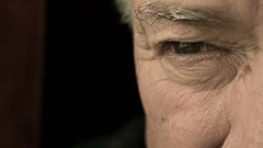 Old man with sad and pensive eye: closeup portrait Arkistovideo
