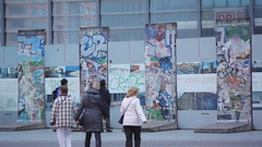 Asian tourists at Berlin Wall remains, Potsdamer Platz, Berlin, Germany Stock Footage