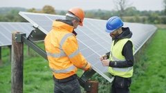 4K Technicians working at solar energy plant, removing a panel for inspection Stock Footage