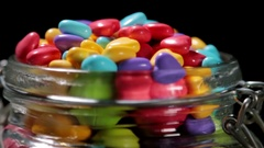Colorful candies and chewing gum in glass jar Stock Footage