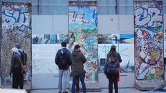 Tourists read info at Potsdamer Platz Berlin Wall remains, Berlin, Germany Stock Footage