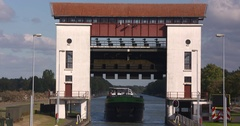 Inland cargo ship slowly enters the lock chamber of Eefde lift lock Stock Footage
