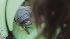 Newborn baby boy sleep in a pram on a walk in the park. Stock Footage
