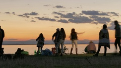 Silhouettes of people on the lake shore Stock Footage