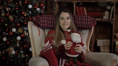 Christmas, New Year, a woman, a girl and a toy Santa Claus welcomes yo Stock Footage
