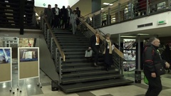 People walking in the lobby and on the stairs Stock Footage