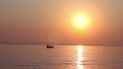 Amazing colors of sunset over summer sea,  ship through golden hour Stock Footage