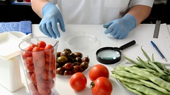Black cherry tomato is carefully being inspected in lab Stock Footage