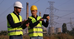 Engineer Man Offering Helpful Assistance to Technician About Transformer Station Stock Footage