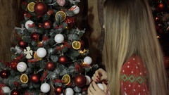 Christmas, New Year, woman, girl, decorate a room, dress up the Christ Stock Footage