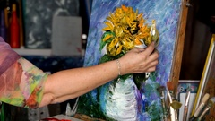 Process of oil painting, artist paints picture on canvas. Sunflowers. Stock Footage